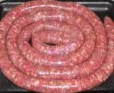 "Boerewors is a type of sausage, popular in South African cuisine. The name comes from the Afrikaans words boer (""farmer"") and wors (""sausage""). Boerewors is made from coarsely minced beef (sometimes combined with minced pork, lamb, or both) and various spices."
